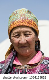 Song Kul, Kyrgyzstan, August 8 2018: Portrait of a beautiful Kyrgyz woman wearing a hat at Song Kul lake in Kyrgyzstan