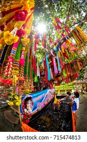 SONG PHI NONG, SUPHANBURI, THAILAND - 22 JULY 2016 : Reminding and respecting past away thai country singer woman with many garlands at Wat Thap kradan Temple, Suphanburi , Thailand