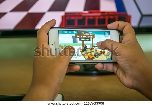 Songkhla, Thailand - August 15, 2018: Boy playing Roblox on Smartphone  a popular game for all devices.