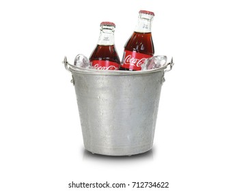 SONGKHLA, THAILAND - August 24, 2017:  Coca-Cola bottle with ice  isolated on white background. Coca Cola is the most popular carbonated soft drink beverages