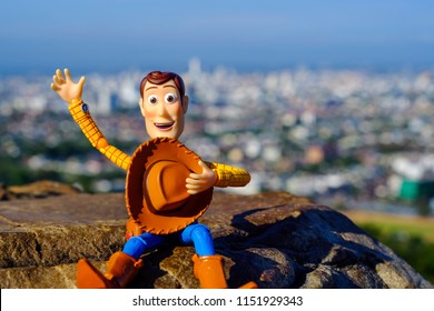 Songkhla, Thailand - August 8, 2018: Woody toy greetings The scenery behind is the atmosphere.This figure by disney Pixar inc.