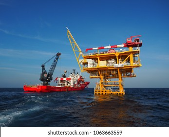 Songkhla, THAILAND – FEBRUARY, 2018: Dive support vessel approaches wellhead platform on February 27, 2018 in Gulf of Thailand.
