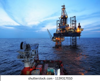 Songkhla, THAILAND – July, 2018: Jack up rig performs drilling operations over static platform in Gulf of Thailand on July 5, 2018.