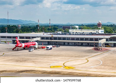 Songkhla, Thailand July 8th, 2019; AirAsia's aircraft is parked at Hat Yai International Airport in the daytime. Air Asia is a low-cost airline that is popular among Thai and foreign tourists.