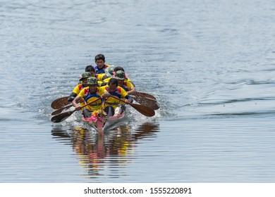 Songkhla,  Thailand - November 03, 2019: Songkhla Long Boat Racing Festival, Unidentified rowers enjoy in native Thai long boats