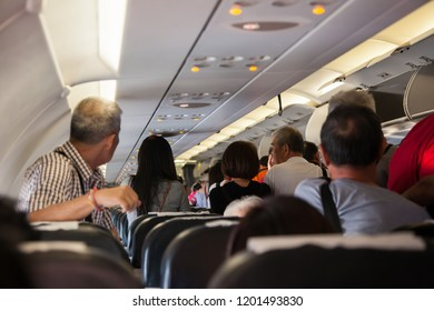 SONGKHLA, THAILAND - OCTOBER 05, 2018: Image of many passengers on passageway inside plane and expecting exit the aircraft after landing.