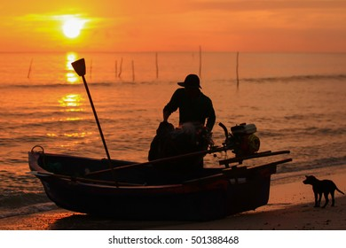 SONGKHLA, THAILAND - October 19 :Beautiful sunrise on the beach and silhouette of fishing boat on October 19, 2016 in Songkhla, Thailand.