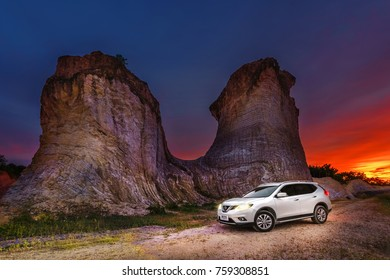 SONGKHLA, THAILAND - OCTOBER 22 2017:White Nissan Rogue on the road to mountain,The Nissan Rogue is a compact crossover SUV produced by the Japanese automaker Nissan.