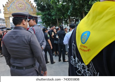 Songkhla, THAILAND - October 26, 2017: Crowd of Thais stand on the queue to join the cremation ceremony by offering sandalwood flowers on the cremation day of His Majesty King Bhumibol Adulyadej.