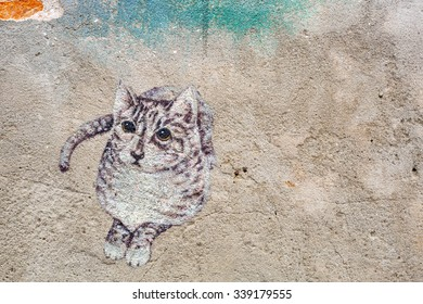 SONGKLA ,THAILAND- CIRCA November 02, 2015: Public street art Cat looking on the wall  in Songkla ,Thailand.