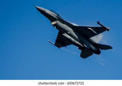 songkla, thailand – January 9, 2016: F-16 air fighter fly in the air with speed and elegance amid the blue sky beautiful background