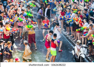 SONGKRAN BANGKOK, THAILAND - April 13: Famous Songkran Festival in Silom on April 13, 2017. One of the most popular water fight places during Songkran in Bangkok, Thailand.