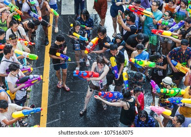 SONGKRAN BANGKOK, THAILAND - April 14: Famous Songkran Festival in Silom on April 14, 2018. One of the most popular water fight places during Songkran in Bangkok, Thailand.