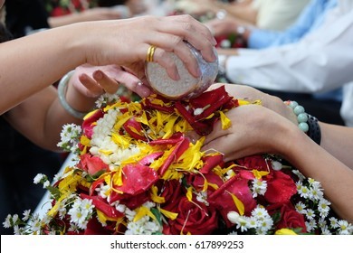 Songkran Festival and pour water on the hands of revered elders and ask for blessing, The culture of the country.
