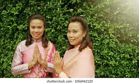 Sawasdee images stock photos vectors shutterstock songkran or welcome to thailand concept twin sisters wearing thai traditional dress making hand sawasdee m4hsunfo Gallery