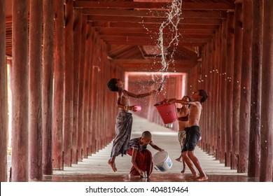 SONGKRAN,SALAY,MYANMAR- Murch 10,2016 Groups children were splashing water