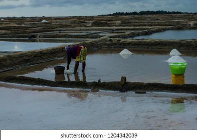 Songor Lagoon, Volta Region, Ghana. A local woman working in salt pans.