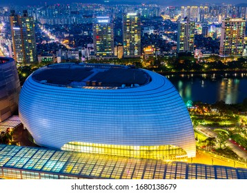 Songpa-gu, Seoul, Korea - April 4, 2019: Night view of Lotte World Mall with the background of apartments and Seokchon Lake.