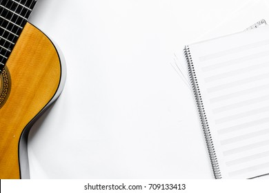 songwriter or dj work place with guitar and notebook on white background top view mockup