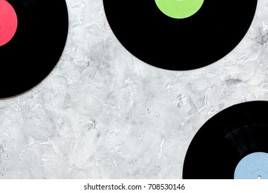 songwriter or dj work place with notebook and vynil record on stone background top view mockup