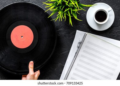songwriter or dj work place with notebook and vynil record on black background top view mockup