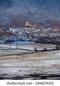 Songzanlin Tibetan Buddhist monastery view in snowing time, Shangri-la, Yunnan Province, China