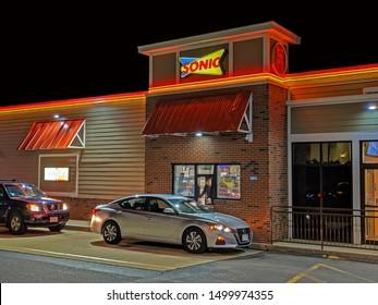 Sonic restaurant drive through window, customer food order pick up, Lynnfield Massachusetts USA, September 7, 2019
