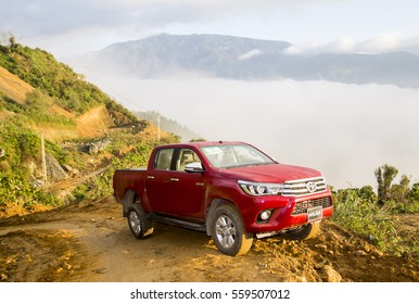 Sonla, Vietnam - Nov 19, 2016: Toyota Hilux 2016 pick-up car running on the mountain road in test drive, Vietnam.