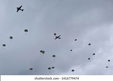 Sonnerville, Normany, France. June 05 2019. Parachutes fill the sky at the D-Day drop zone near Caen, Normandy part of Dax over Normandy in which Dakota aircraft carried airmen from RAF Duxford