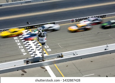 SONOMA, CALIFORNIA - JUNE 23, 2019: Green flag at the start of the Toyota/Save Mart 350 at Sonoma Raceway. Martin Truex, Jr., won the race, holding off Kyle Busch in the last laps.