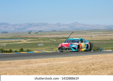 SONOMA, CALIFORNIA - JUNE 23, 2019: Kyle Busch's Toyota sports a dented hood in the Toyota/Save Mart 350 at Sonoma Raceway. Martin Truex, Jr., won the race, holding off Busch in the last laps.
