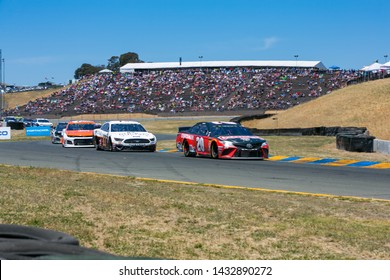 SONOMA, CALIFORNIA - JUNE 23, 2019: Racecars in Turn 8 at the Toyota/Save Mart 350 at Sonoma Raceway. Martin Truex, Jr., won the race, holding off Kyle Busch in the last laps.