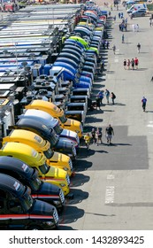 SONOMA, CALIFORNIA - JUNE 23, 2019: Precisely parked trucks for Nascar racing teams on display before the start of the Toyota/Save Mart 350 at Sonoma Raceway.