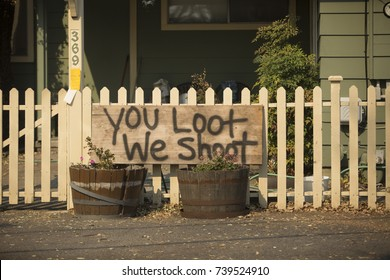 "SONOMA, CALIFORNIA/ USA - OCTOBER 14, 2017: Homemade ""YOU LOOT WE SHOOT"" sign in the Boyes Hot Springs neighborhood. Fires in California have burned over 220,000 acres and destroyed 5700 structures."