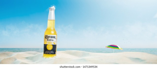 SONORA, MEXICO - AUGUST 02 2019, beer bottle on the beach in summer with blue sky