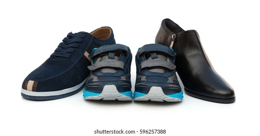 sons shoes surrounded by dad and moms