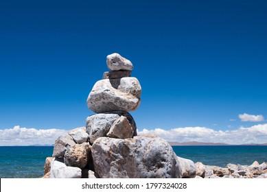 SONY DSC Mani pile on the edge of Lugu Lake