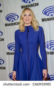 """Sophie Turner arrives at the 2019 WonderCon press room for """"Dark Phoenix"""" on March 29, 2019 at the Anaheim Convention Center in Anaheim, CA."""