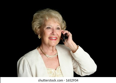 A sophisticated senior lady enjoying a cell phone conversation.