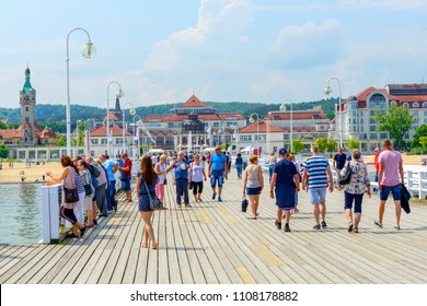 SOPOT - MAY 26: Tourists enjoy the sunny weather and walking along the pier on 26 May 2018 in Sopot, Poland.