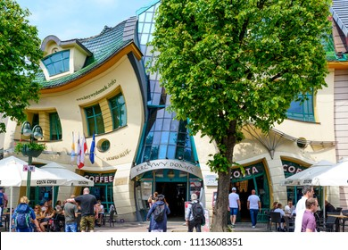 SOPOT - MAY 26: Tourists are walking in front of a crooked house on 26 May 2018 in Sopot, Poland. It was built in 2004 as part of the Resident's shopping center.