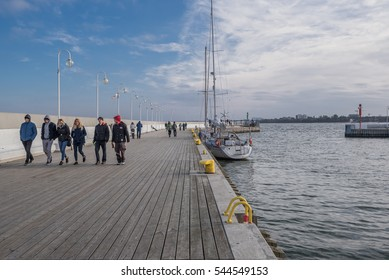 Sopot Pier & new Yacht Marina, Poland-October 15, 2016: Famous polish landmark, the longest wooden pier in Europe, popular for health walks & recreation, offers great views of the Baltic sea