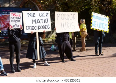 """Sopot, Poland, 2016 09 24 - protest against anti-abortion law forced by Polish government; people with banners"""" people of PIS you'll go to hell for this law, do not teach mother how to give birth"""