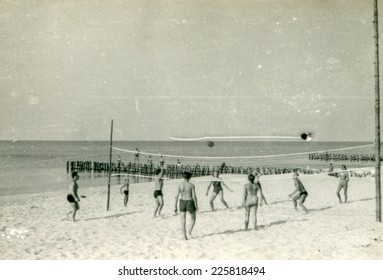SOPOT, POLAND, CIRCA FIFTIES: Young people play volleyball on the beach, vintage photo