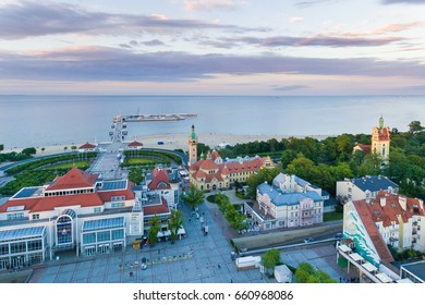 Sopot, Poland - June 10 2017: Bird-eye view of Sheraton hotel against the wooden pier on the background in evening