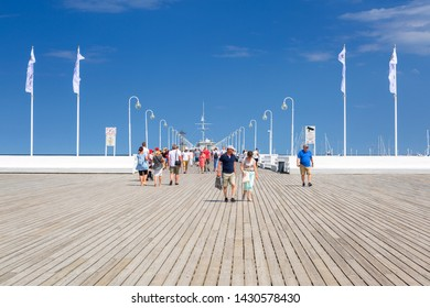 Sopot, Poland - June 19, 2019: People on the pier by Baltic sea in Sopot, Poland. Sopot is major tourist destination in Poland with the longest wooden pier.