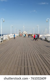 Sopot, Poland - September 28, 2017: Few people at the wooden pier in Sopot, Poland, on a sunny day in the autumn.