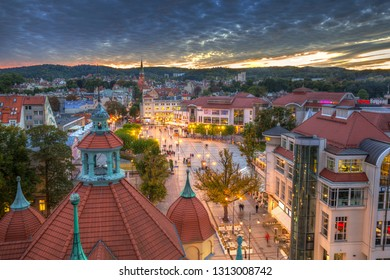 Sopot, Poland -  September 30,  2018: People walking at the main square in Sopot city at dusk, Poland. Sopot is major health and tourist resort destination and has the longest wooden pier in Europe.