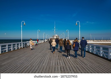 SOPOT, POLAND-JULY 23,2019: The Sopot Pier is the pier in the city of Sopot, Poland, built as a pleasure pier and as a mooring point for cruise boats. It first opened in 1827, and at 511.5 metres.