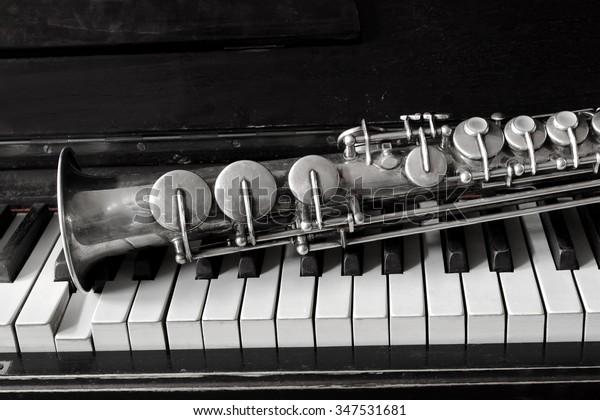 Soprano Saxophone On Piano Keys Stock Photo (Edit Now) 347531681